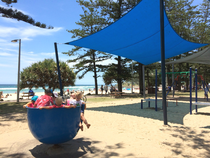 kids on blue spinner at justins park the esplanade gold coast