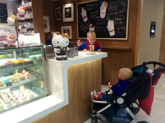 hello kitty cafe hong kong counter with jack in stroller pic