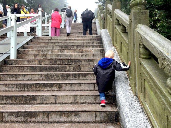 ngong ping 360 jack walking up stairs