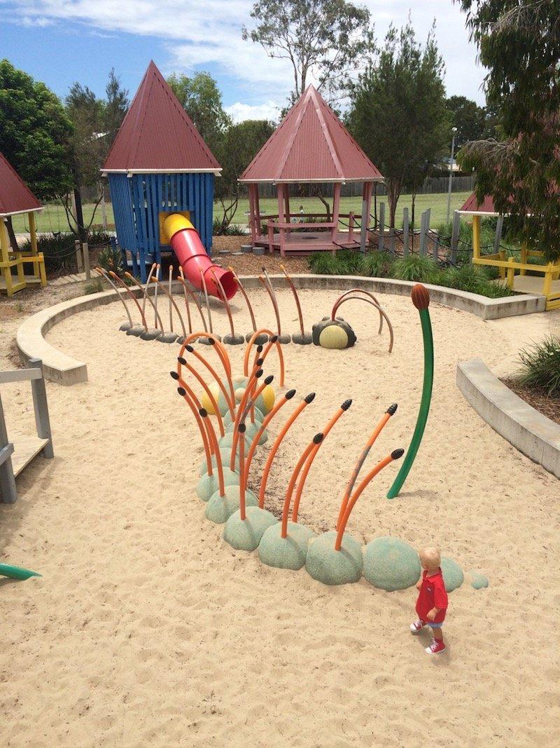 photo - hidden world playground fitzgibbon caterpillar sandpit
