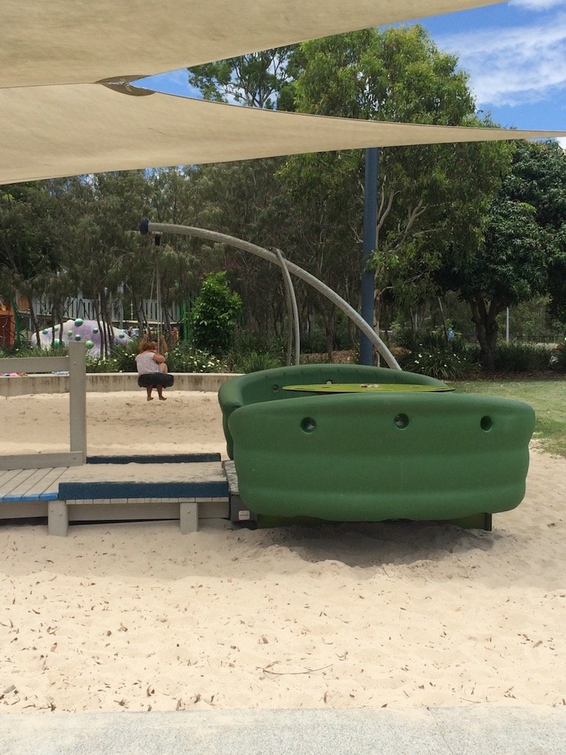 photo - hidden world playground sway ride
