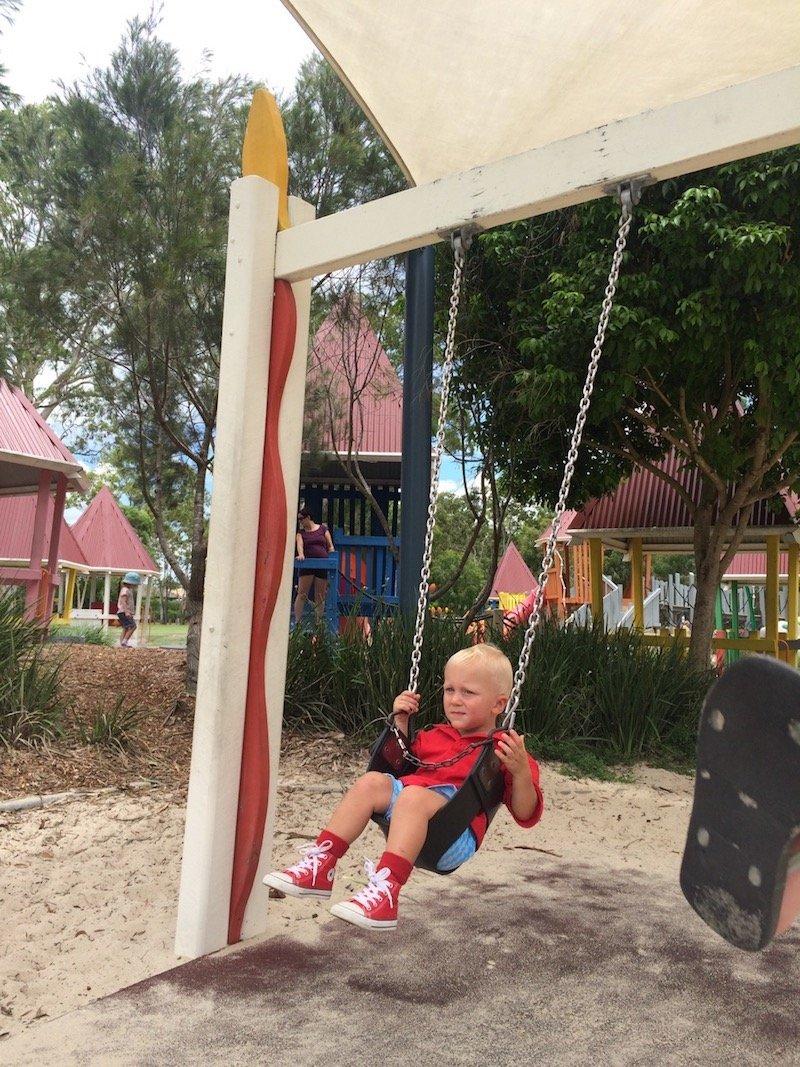 photo - hidden world playground swings