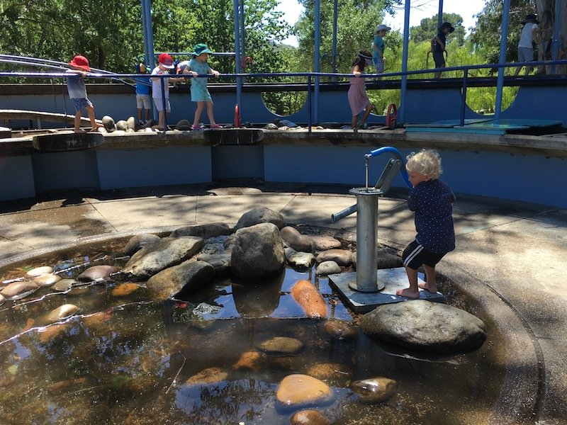 weston park adventure playground for kids water pump pic