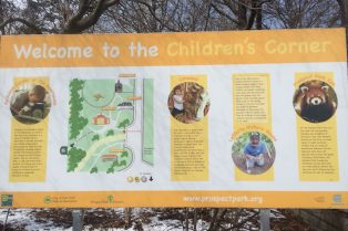 Visit ROAM THE GNOME Family Travel Website Directory for SUPER DOOPER FUN ideas for family vacations around the world. Search by city. Photo - Childrens Corner Prospect Park sign
