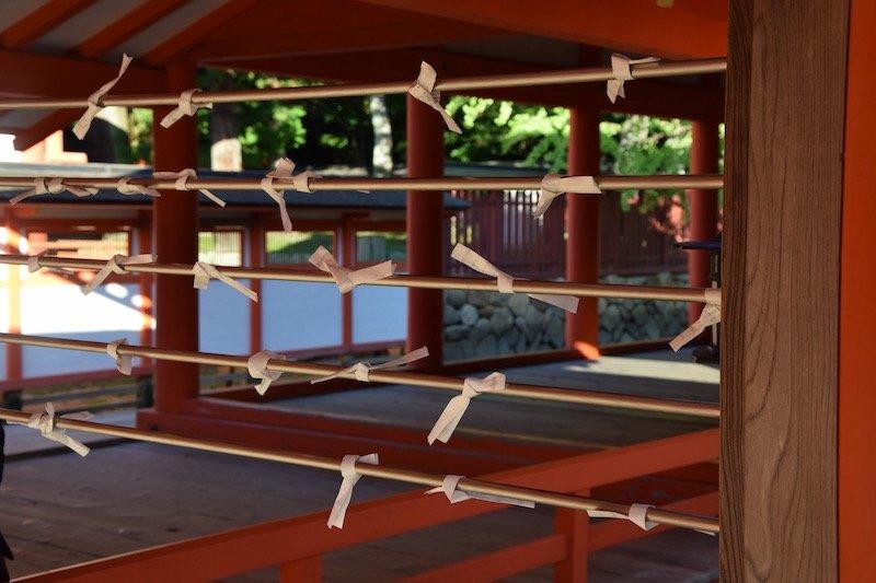 omikuji papers at miyajima shrine japan