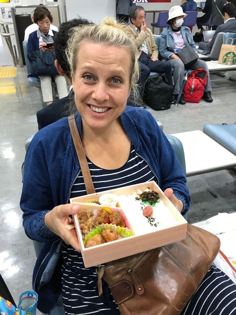 amber eating bento at tokyo train station pic