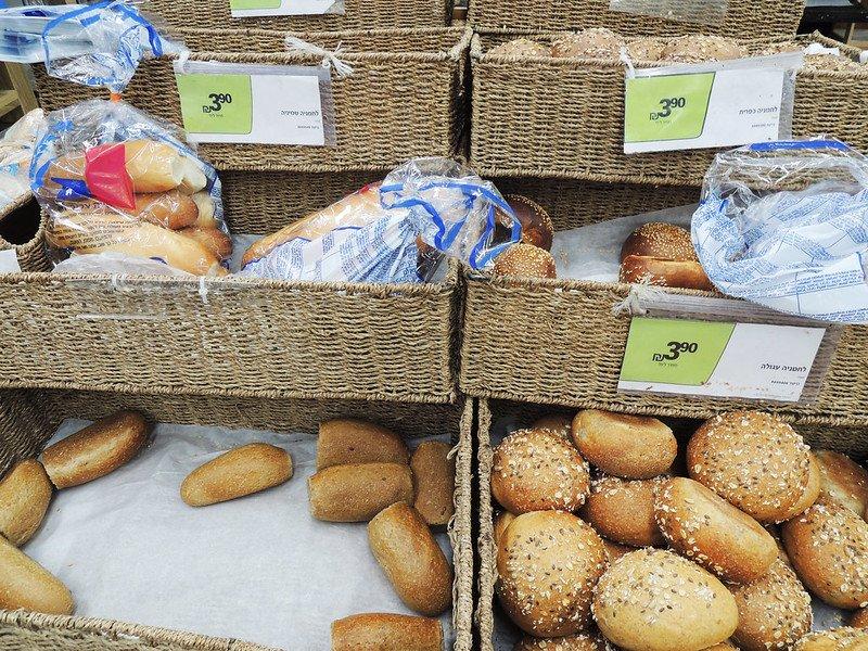 bread rolls at the supermarket by piotr rokita