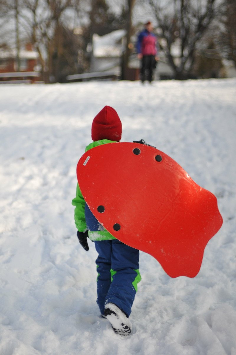child on sled by quio media group