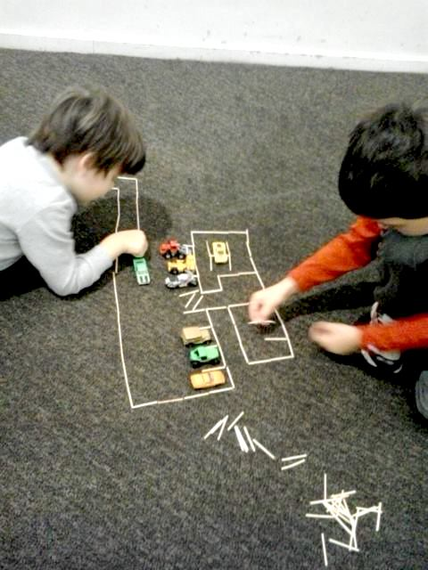 katrina boys matchstick cars in airport travel hack1