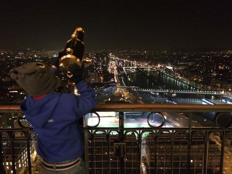 eiffel tower with kids at night pic