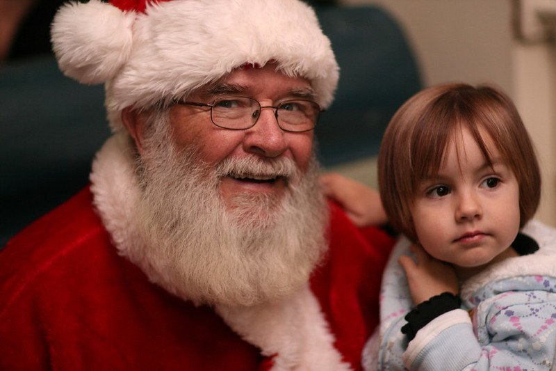 santa with child on polar express by joe osterloh