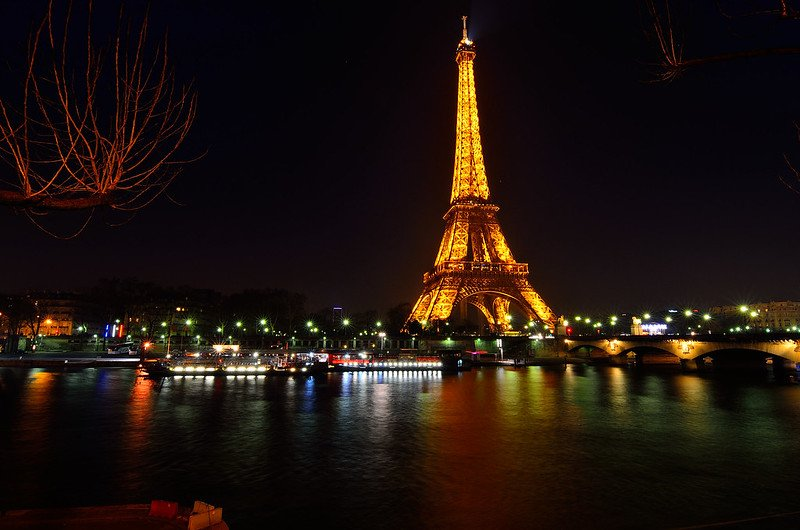 eiffel tower at night by javier vieras