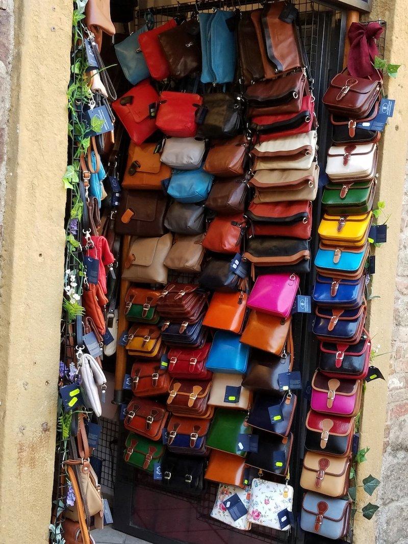 italian leather handbags wall of bags - public domain pics copy