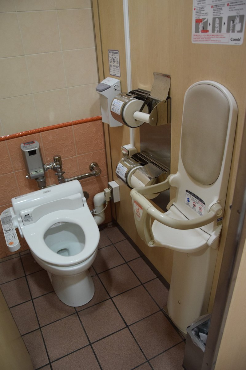 japanese toilet with toddler seat pic