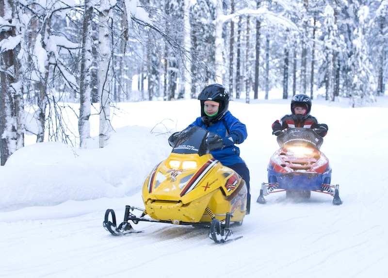 best things to do in rovaniemi in winter - snowmobile by visit rovaniemi