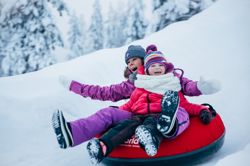 snowtubing at snowman world image by visit rovaniemi