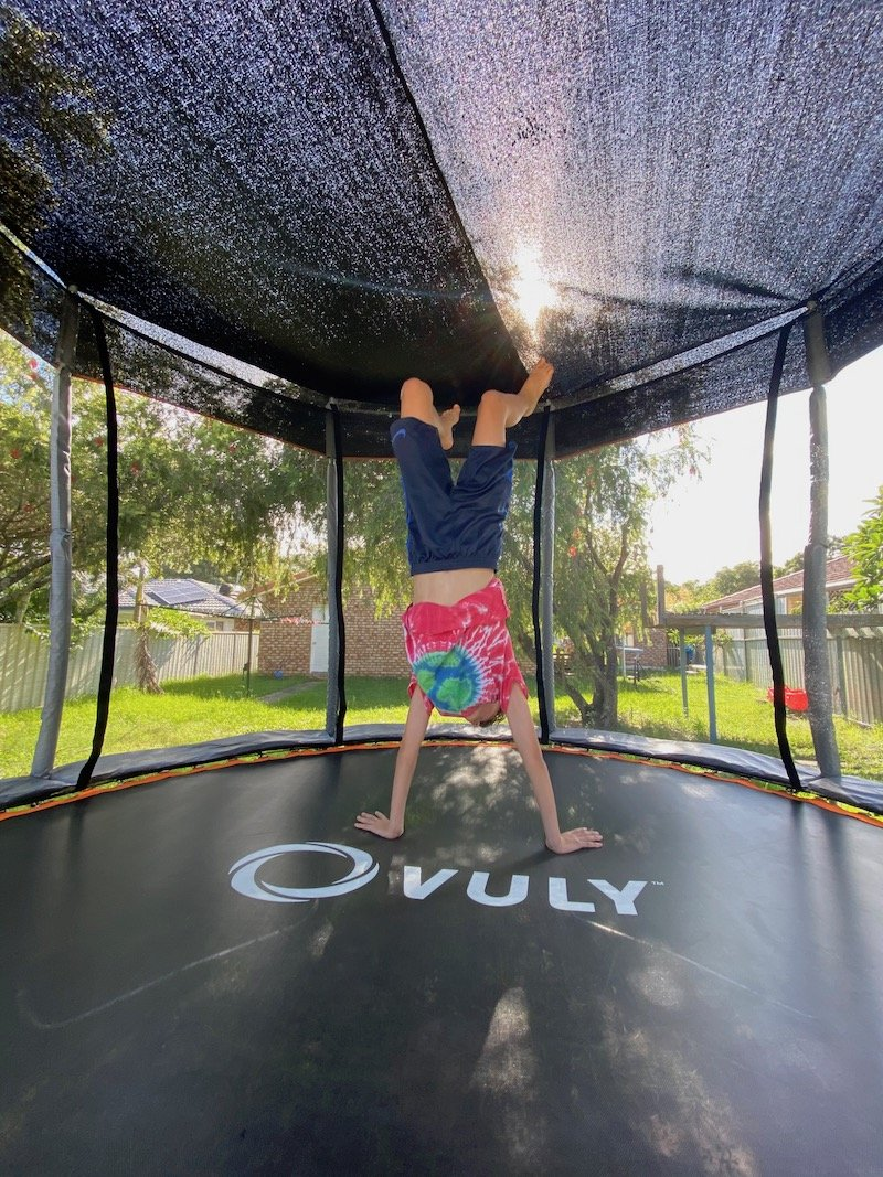 best tricks on a trampoline pic - handstand