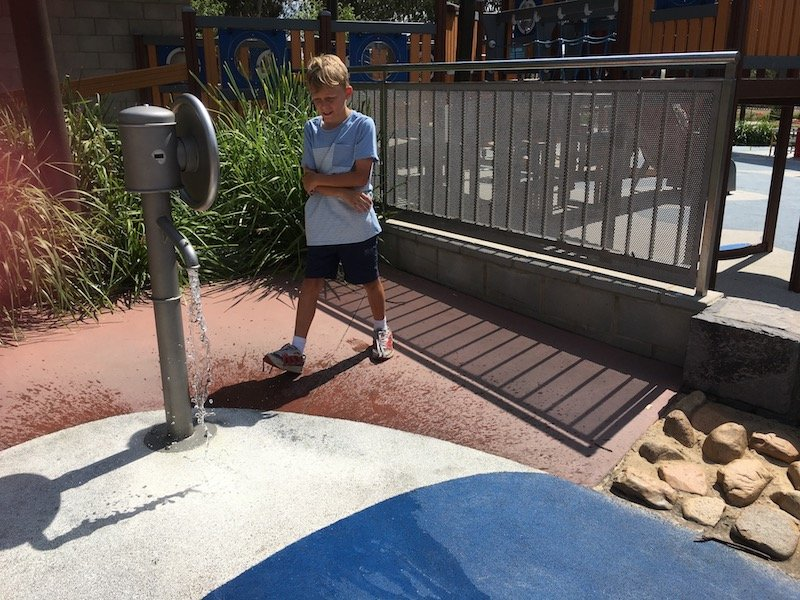 boundless playground water pump play pic