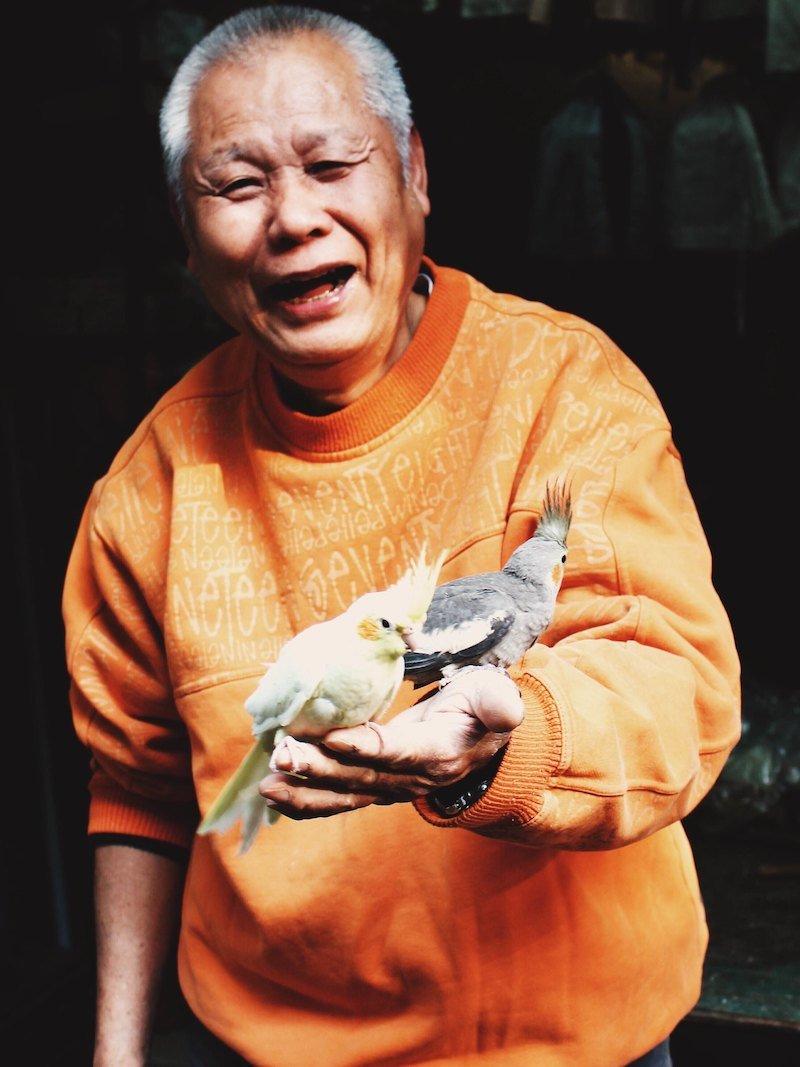 hong kong bird gardens keeper by kristina kovalenko