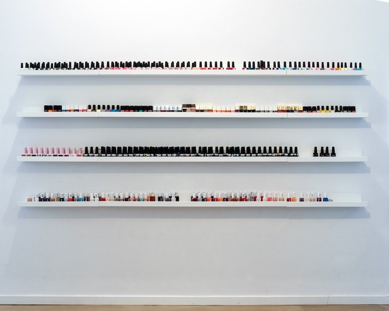 nail polish collection on floating shelves by yannes-kiefer