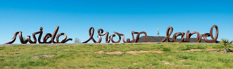 wide brown land sculpture at arboretum by franz venhaus flickr
