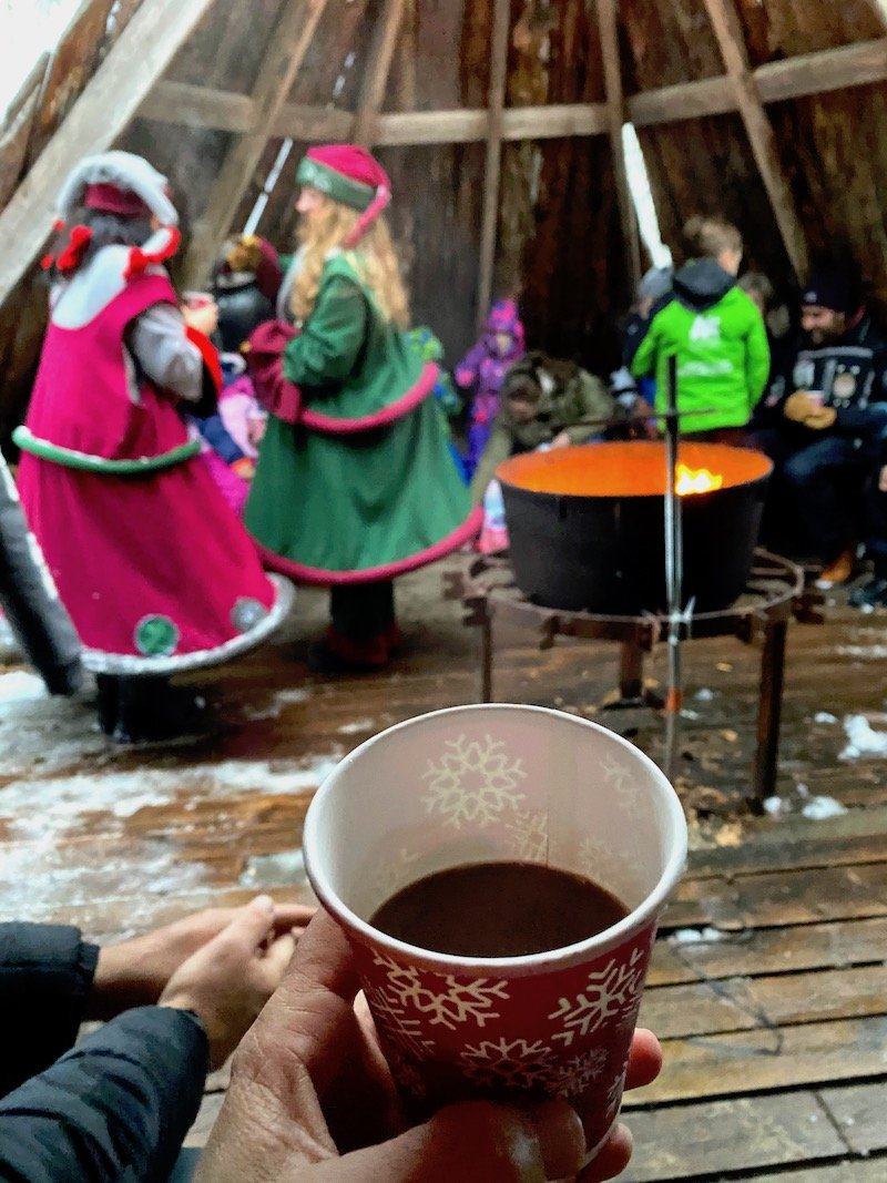Image - Lapland elves giving out hot chocolate at santa claus secret forest of joulukka