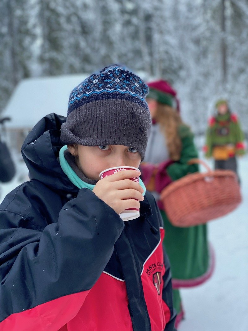 Image - drinking juice at santa claus secret forest of joulukka tour