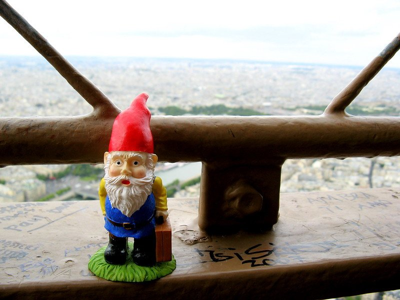 gnome at the top of the eiffel tower by harshlight