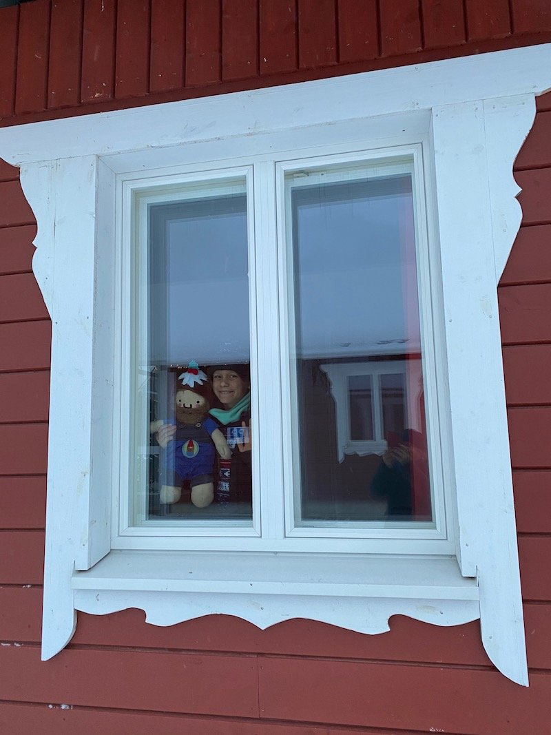 image - ned at window of santa claus holiday village cabin