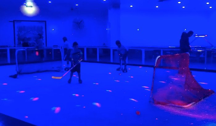Planet Chill Ice Skating hockey game pic