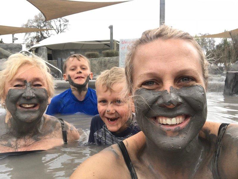 Photo - family at mud spa pools at hells gate rotorua