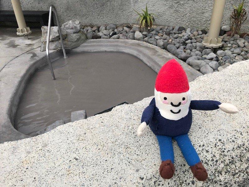 Photo- mud bath pool with roam the gnome