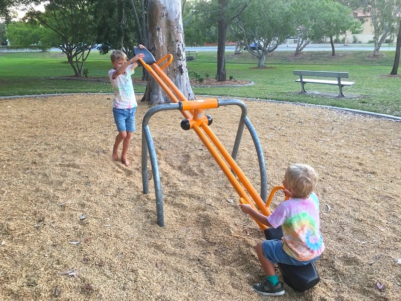 photo - lions playground helensvale seesaw with boys