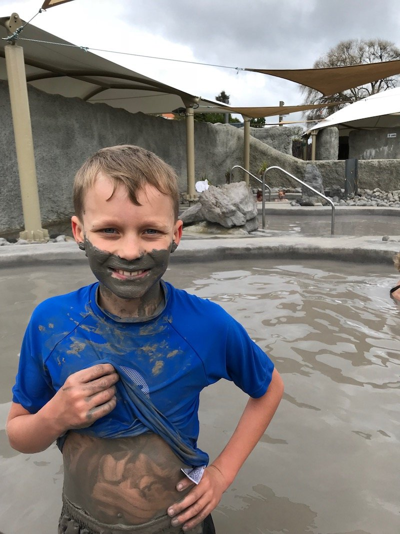 photo - ned smiling at mud baths in rotorua