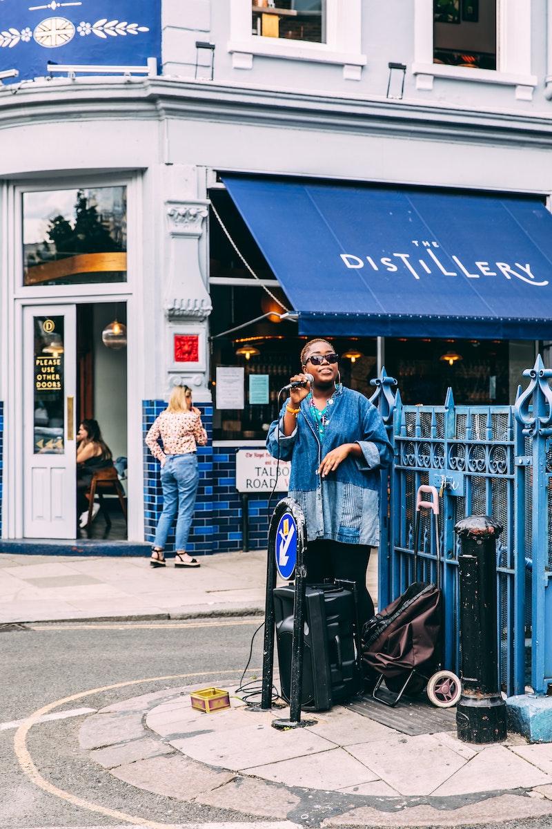 image - portobello market london busker by simon-rae