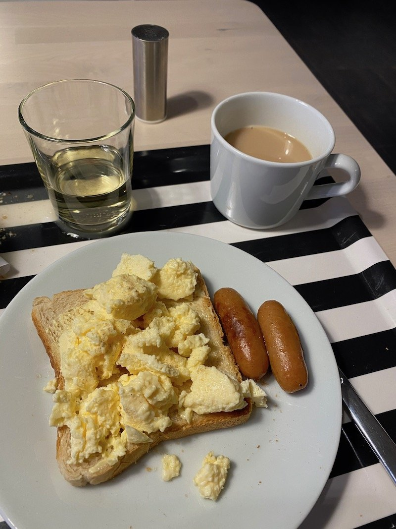 image - ikea hotel breakfast eggs on toast sausages and bacon