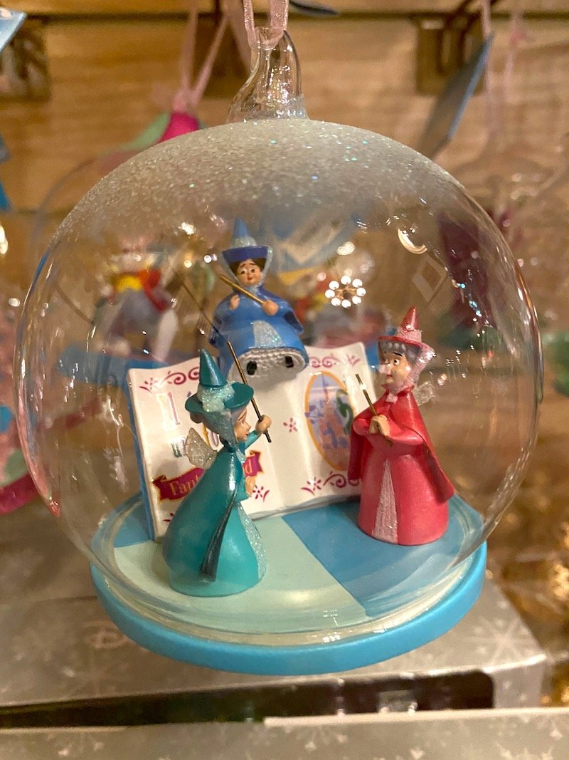 image - disneyland paris christmas globe with Flora, Fauna, and Merryweather
