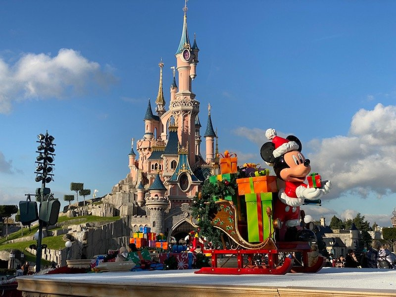 image - disneyland paris christmas mickey statues in front of castle