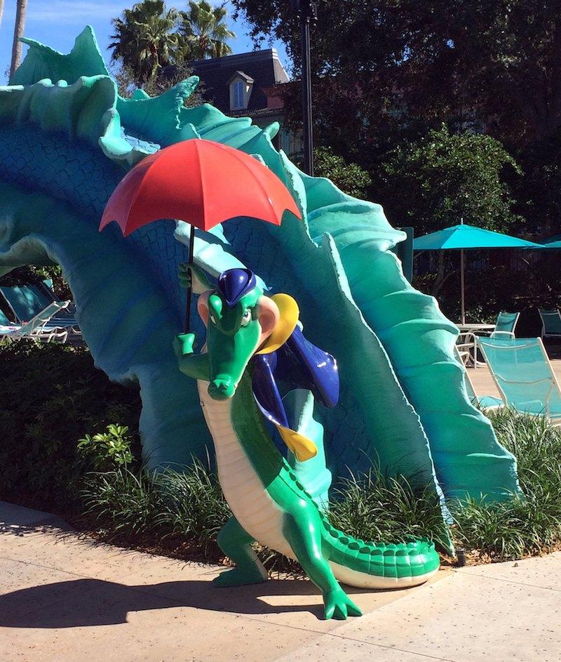 image - disney port orleans resort french quarter swimming pool alligator statue by jared flickr