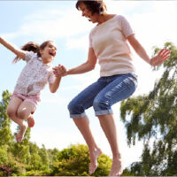 image - mum and daughter jumping on the trampoline