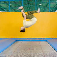 image - trampoline tricks with yellow wall